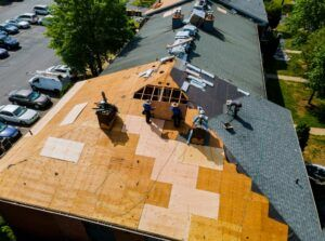 Photo of roofing team, installing roof. Roof Installation - Brajar Roofing Company - Hickory, North Carolina