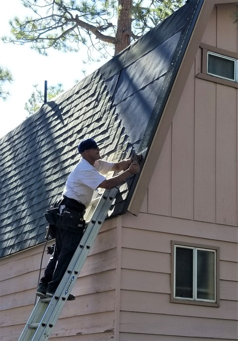 Photo of roofing team, repairing roof. Roof Installation - Brajar Roofing Company - Hickory, North Carolina